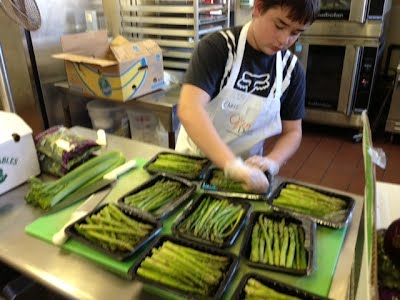 Preparing the asparagus for the Open Door meal.