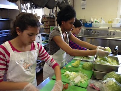 Carefully chopping up the vegetables for our special meal. Careful with those knives girls!